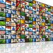 Large wall of tv screens with various images — Stock Photo #5042856