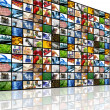Large wall of tv screens with various images — Stok fotoğraf