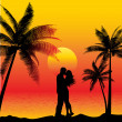 Couple kissing on beach - Stockfoto