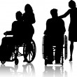 Man in wheelchair with woman - Stock Photo