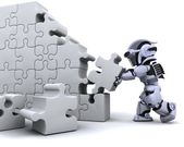 Robot solving jigsaw puzzle — Stock Photo