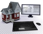 Classic Timber House with computer and blueprints — Stock Photo