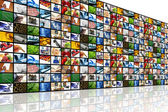 Large wall of tv screens with various images — Stock fotografie
