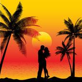 Para całuje na plaży — Zdjęcie stockowe