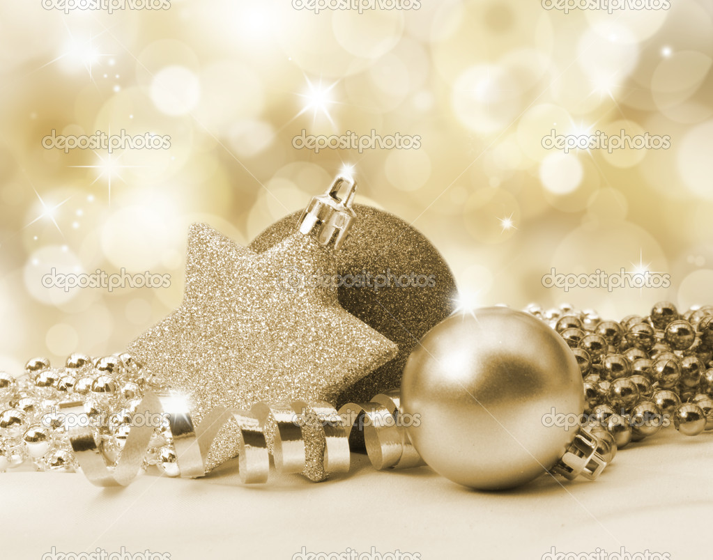 Golden Christmas background with decorations and beads — Stock Photo #5048808