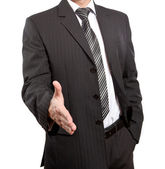 Business man with an open hand ready to seal a deal — Stock Photo