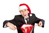 Young guy with a red bag in Santa Claus hat — Stock Photo