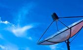 Satellite dish in blue sky — Stock Photo