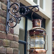 Stock Photo: Traditional lantern hanging outside Edam house.