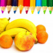Royalty-Free Stock Photo: Fruits and pencils