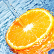 Orange in water splash - Stock Photo