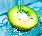 Kiwi in water splash — Stock Photo