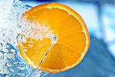 Orange in water splash — Stock Photo