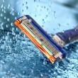 Razor with water splash — Stock Photo