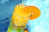 Orange juice with slices of orange in the glass — Stock Photo