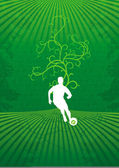 Stylish football player with beautiful flora background — Stock Photo