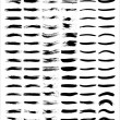 A set of vectorized grungy brush lines - Stock Vector