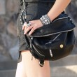 Stylish Woman Carrying Black Handbag - Stock Photo