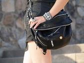 Stylish Woman Carrying Black Handbag — Stock Photo