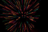 Fireworks,colored splashes of light against a dark background — Stock Photo