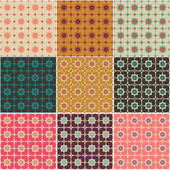 Hearts and flowers seamless patterns — Stock Vector