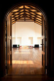 Two doors leading into a large hall — Stock Photo