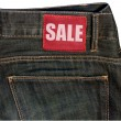 Jeans with Sale Sign — Stock Photo