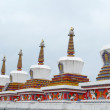 Landmarks of Tibetan stupa in a lamasery - Stock Photo