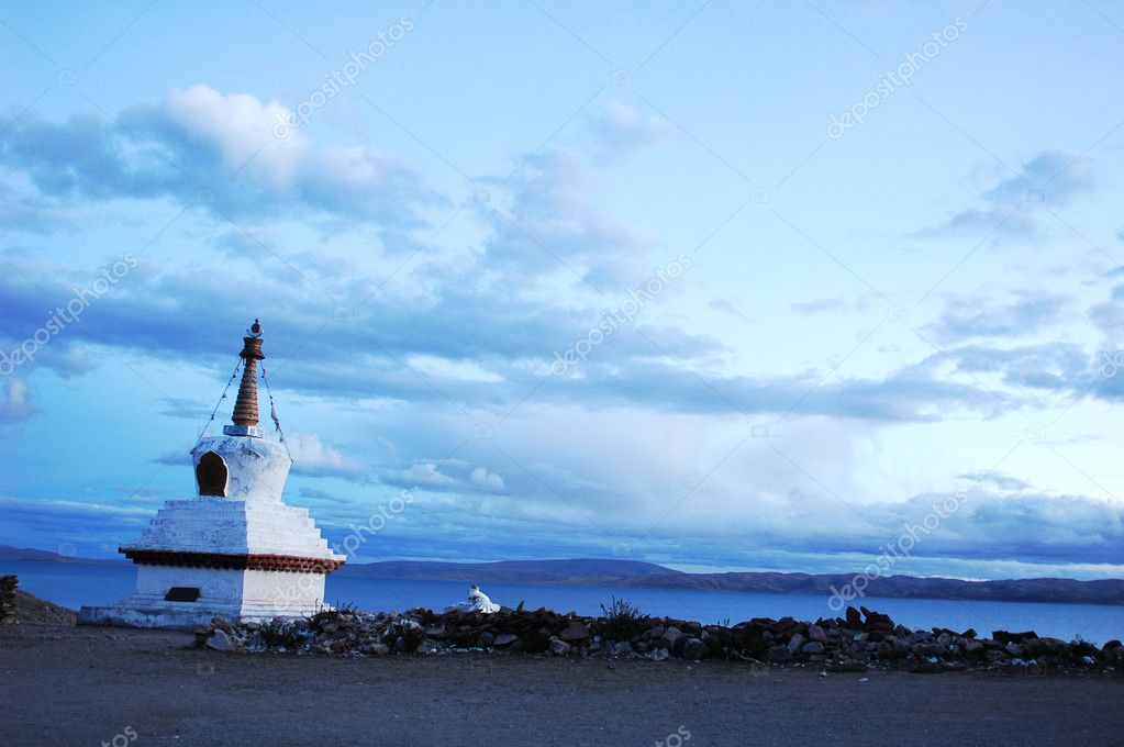 Landscape of a white stupa by a lake in Tibet  Stock Photo #4673765