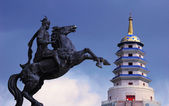 Statue of Mongolian saber and a Pagoda — Stock Photo