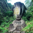 Statue of smiling buddha - Stock Photo