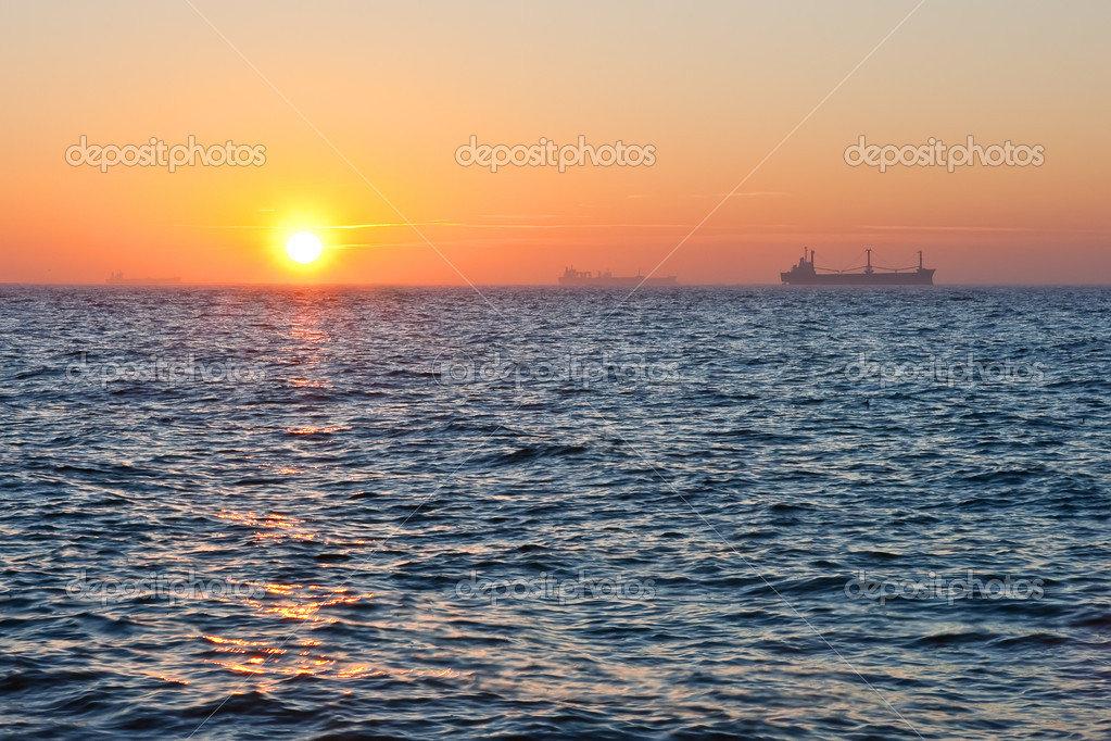 Sunrise in the sea. Ships at the background. — Stock Photo #4352442
