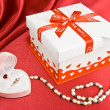 Stock Photo: Present box and jewelry.