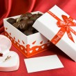 Box of chocolates with opened box for a rings. — Stock Photo