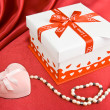 Present box and jewelry. — Stock Photo