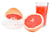 Juicer, cut a grapefruit and a glass of juice. — Stock Photo