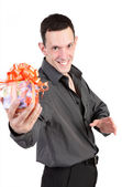 The guy with a gift isolated on a white background — Stock Photo