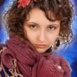 Beautiful girl with a scarf and mittens — Stockfoto
