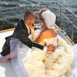 Happy bride and groom on a luxury yacht. — Stock Photo #4337744