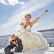 Happy groom and the bride on the yacht in solar and bright day — Stock Photo