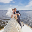 Stock Photo: Happy bride and groom on a luxury yacht.