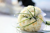 Wedding bouquet of the bride from roses — Stock Photo