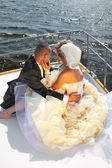 Happy bride and groom on a luxury yacht. — Stock Photo