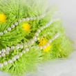 Necklace of pearls and bouquet of chrysanthemums — Stock Photo
