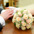 Stock Photo: Hands with rings and wedding bouquet