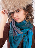 Pretty girl in a fur hat — Stock Photo
