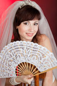 Bride with a fan — Stock Photo