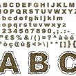 Burnt parchment alphabet - Stock Photo