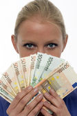Portrait of a young caucasian woman holding money — ストック写真