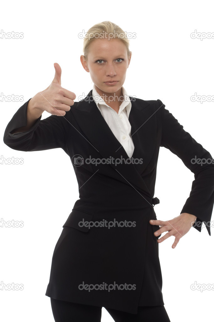 Portrait of a young caucasian businesswoman with thumb up and aggressive air wearing a jacket and trousers — Stock Photo #4452912
